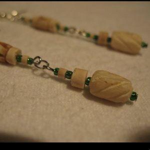 Bone and glass beads earrings.